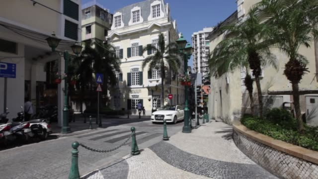 macau , china; september 24, 2016; the holy house of mercy was built by the first bishop of macau and is located in senado square. the exterior is... - leal senado square stock videos & royalty-free footage