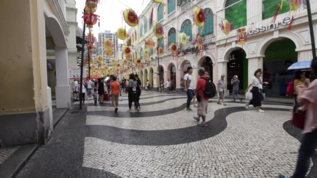 macau, china; september 24, 2016; the senado square, or senate square, is a paved town square in sé, macau, china and part of the unesco historic... - leal senado square stock videos & royalty-free footage