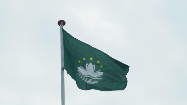 macau flag - macao flag stock videos and b-roll footage