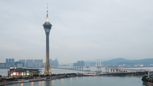 Macau Tower And Macau Bridge Landmark Place Of Macau China Day and Night Time