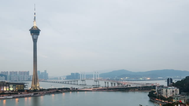 Macau Tower And Macau Bridge Landmark Place Of Macau China Day and Night Time