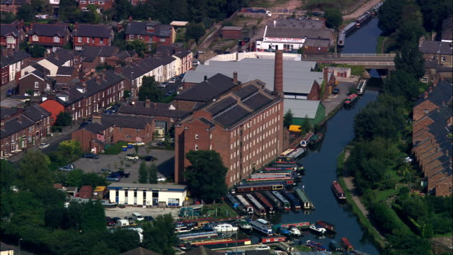 macclesfield and original hovis bread mill  - aerial view - england, cheshire east, united kingdom - cheshire england stock videos & royalty-free footage