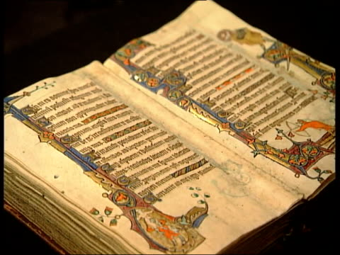 Macclesfield Psalter to stay in country ENGLAND INT music overlay Medieval Religion CS Macclesfield Psalter TILT DOWN TCMS hands opening pages of...