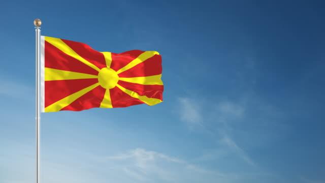 stockvideo's en b-roll-footage met 4k macedonië flag - loopbare - paalzitten