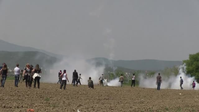 macedonia police fire tear gas and stun grenades at migrants staging a protest at the countrys border fence with greece - hand grenade stock videos & royalty-free footage