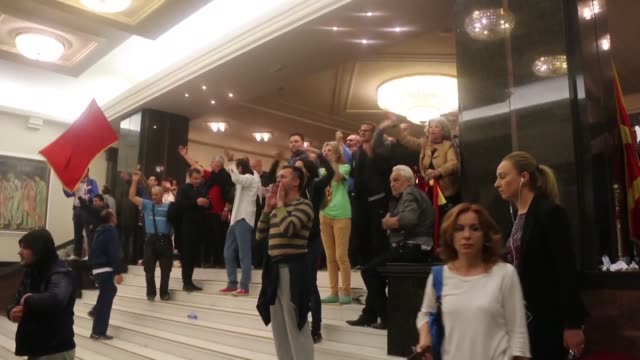 vídeos de stock, filmes e b-roll de macedonian lawmaker is in critical condition and eight more have suffered injuries after masked protesters attacked and sequestered them inside the... - república da macedônia