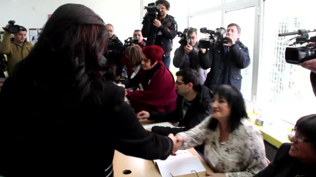 vídeos de stock, filmes e b-roll de macedonian president gyorge ivanov and his wife maja ivanova cast their ballots for the parliamentary elections in skopje macedonia on december 11... - república da macedônia