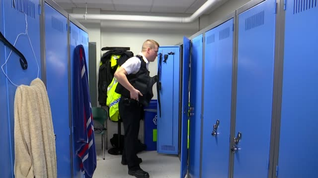 machete attack survivor pc stuart outten returns to front-line policing; england: london: int side view pc stuart outten along and opening locker and... - vest stock videos & royalty-free footage