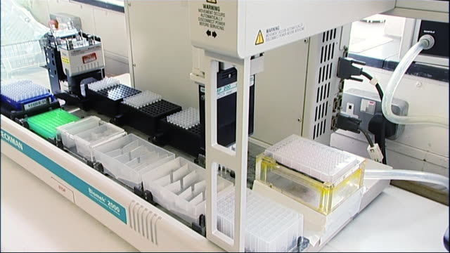 a machine automatically pipettes liquid into multiple test tubes in a laboratory whilst tests for bird flu and h5n1 are undertaken 2005 - audio available stock videos & royalty-free footage