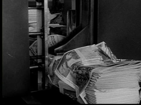 1955 ms pan machine binding newspapers into bundles for delivery/ bundles moving on and sliding down chute/ buffalo, new york - stack stock videos & royalty-free footage