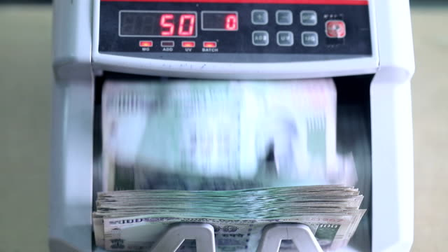 machine counting indian banknotes - bank stock videos & royalty-free footage