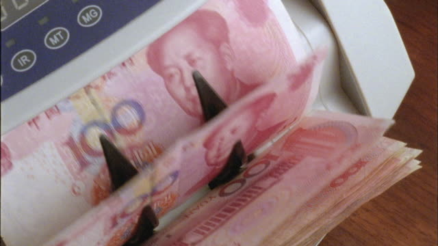 ecu, ha, machine counting one hundred yuan bills - chinese currency stock videos & royalty-free footage