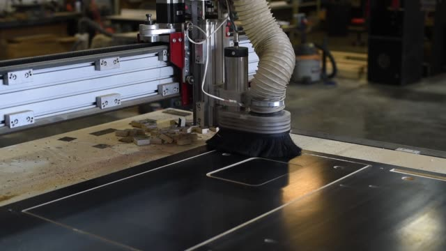 a cnc machine cuts out the cabinet panels for a vertigo style virtual pinball machine at vpcabs in fairfield ohio on june 1 2017 shots generic... - pinball machine stock videos & royalty-free footage