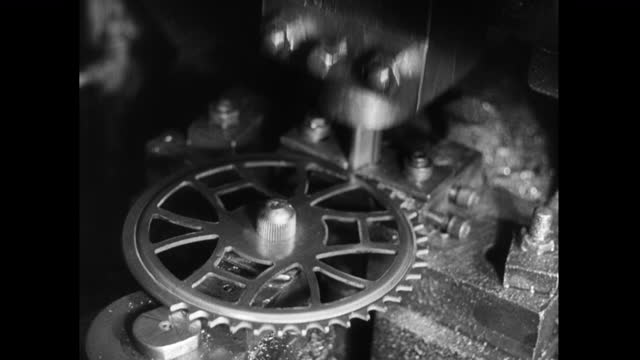 cu machine cuts teeth out of a metal gear disk; 1952 - 1952 stock videos & royalty-free footage