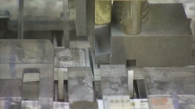 cu machine cutting completed one hundred dollar bills / washington d.c., washington d.c., united states - money press stock videos and b-roll footage