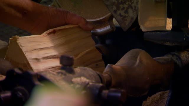 Machine cutting out a wooden shoe at Dutch village