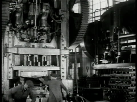 vídeos de stock e filmes b-roll de machine factory turbines ms russian workers operating press machine ms gears turning ws men removing pressed metal ms joseph stalin picture on wall... - baixar