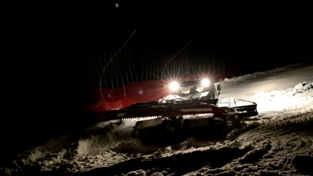 machine for leveling the ski slopes works at night. - ski slope stock videos & royalty-free footage