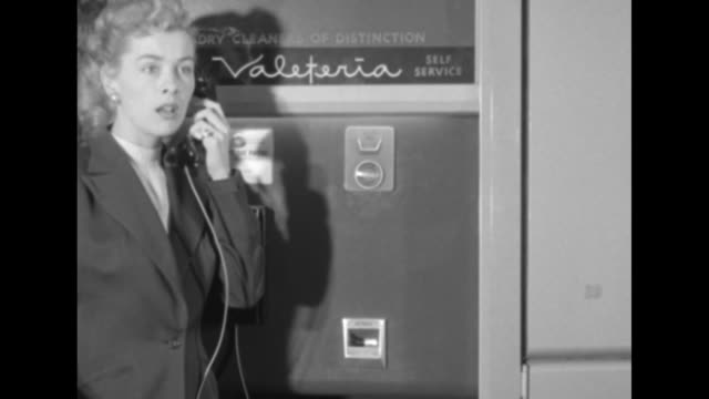 machine front with telephone and coin slot sign reading valeteria woman enters picks up receiver reads numbers on receipt during conversation with... - telephone receiver stock videos & royalty-free footage