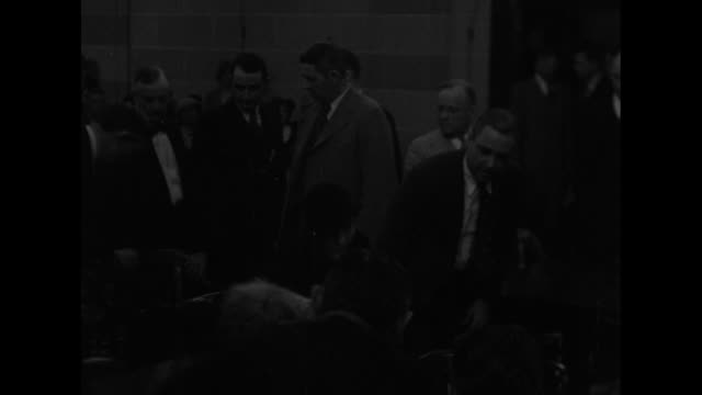 machine gun kelly's wife kathryn led to car by group of men / machine gun kelly enters courtroom in oklahoma city and sits next to wife for... - jury box stock videos & royalty-free footage