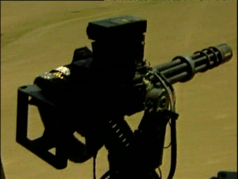 vidéos et rushes de machine gun mounted in royal marines chinook helicopter flying over mountains war in afghanistan 2001 - guerre d'afghanistan : de 2001 à nos jours