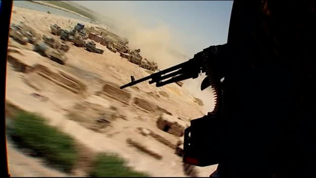 machine gun mounted on helicopter as along over british army base - british military stock videos & royalty-free footage