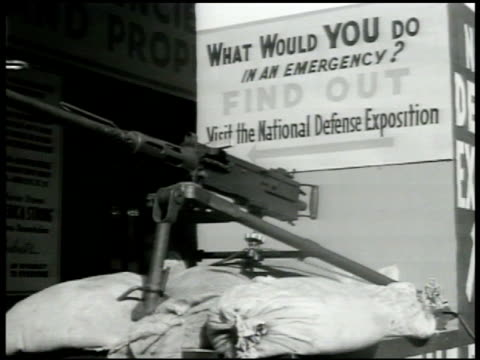 machine gun on sand bags in front of civil defense banner 'what would you do in an emergency' civil defense communication booth w/ policeman... - emergency planning stock videos & royalty-free footage