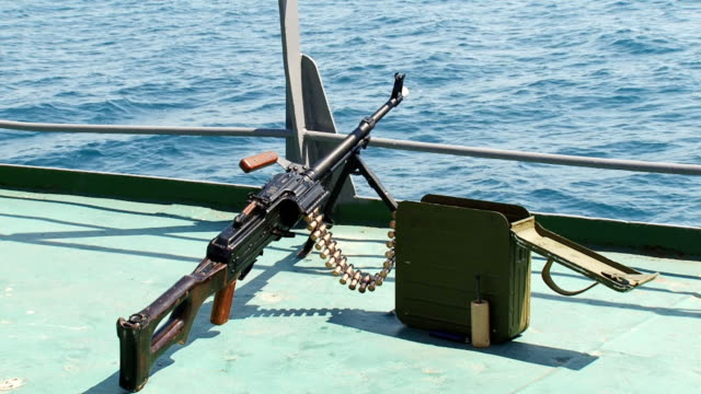 machine gun on the deck of a ship - terrorism stock videos and b-roll footage