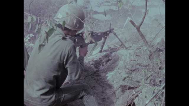 machine gunner of the 9th arvn division fires into cave - south vietnam stock videos & royalty-free footage