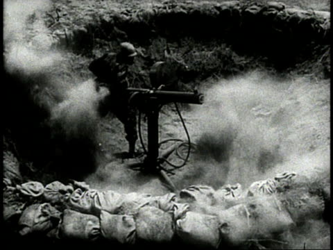 WS Machine guns standing in sandbagged pit / MS Black US Army soldier leaping into pit and manning gun / WS Japanese Zero flying overhead / CU...