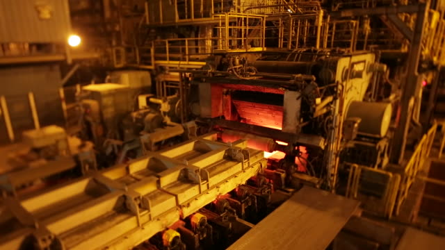 Machine in a steel mill producing iron ingot
