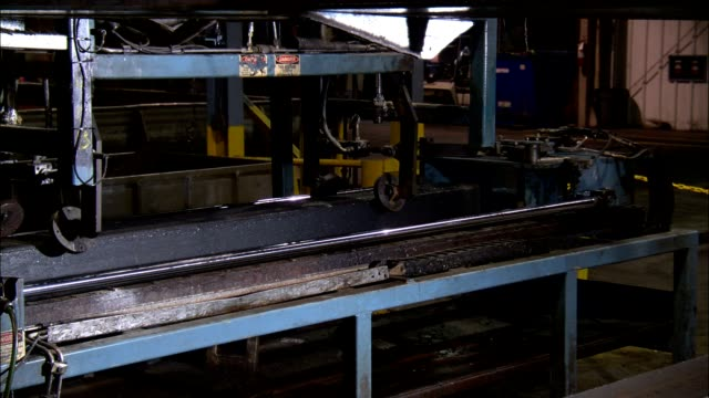 a machine lifts a plastic railroad tie in a factory. - recycling stock videos & royalty-free footage
