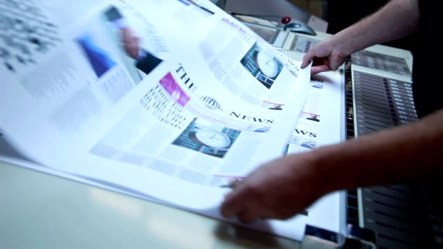 machine minder... - newspaper page stock videos and b-roll footage