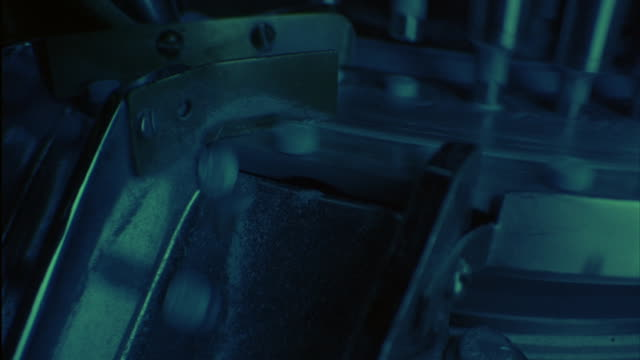 A machine moves quickly to manufacture blue pills.