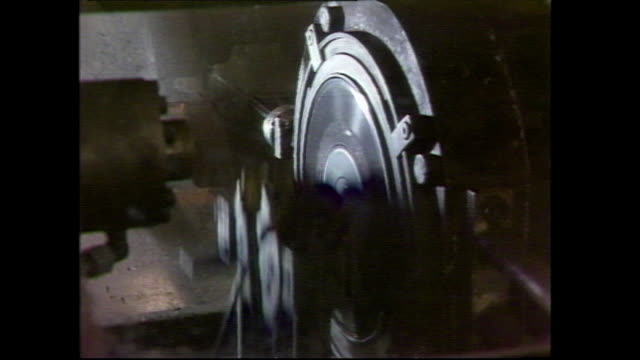 machine presses labels onto vinyl records; 1983 - label stock videos & royalty-free footage
