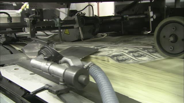 A machine prints sheets of US dollar bills.