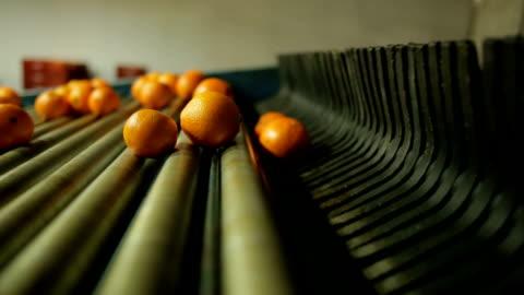 machine running in orange industry - industry stock videos & royalty-free footage