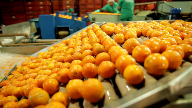 machine running in orange industry - orange colour stock videos & royalty-free footage