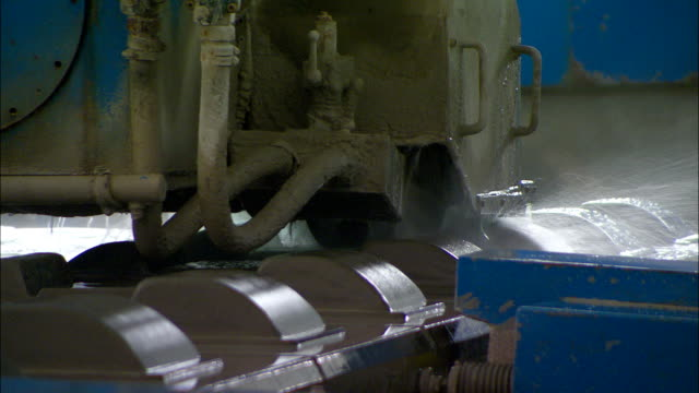 a machine shapes concrete railroad ties in a factory. - beton stock-videos und b-roll-filmmaterial