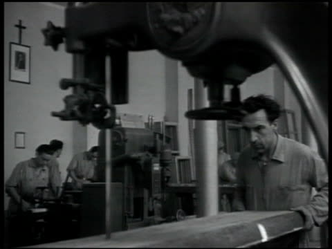 machine shop men working vs men sawing & moving wood men pulling on rope ext scaffold on building men hoisting scaffold upward by building. - 1940 stock videos & royalty-free footage