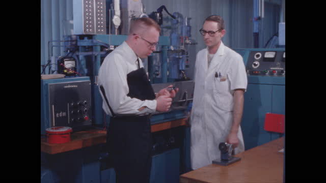 machine shop two machinists confer over part - micrometer stock videos & royalty-free footage
