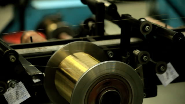 machine tool reeling up a wire on the coil - thin stock videos & royalty-free footage