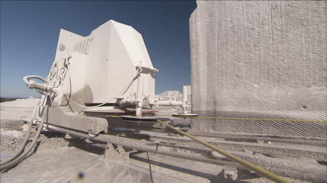 a machine uses a taut cable to cut granite. - granite rock stock videos & royalty-free footage
