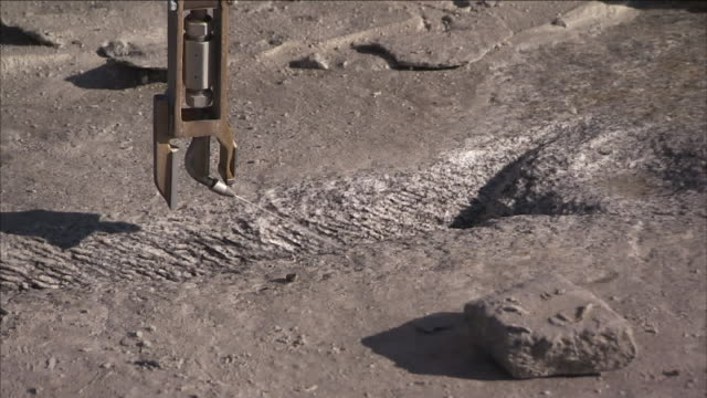 a machine uses water under high pressure to cut granite. - granite rock stock videos & royalty-free footage
