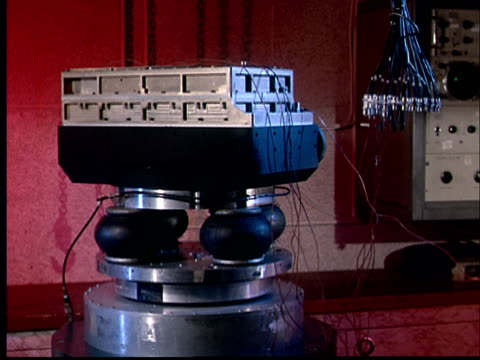 1970 ms machine with wires attached bouncing up and down on four rubber shock absorbers attached to metal disc - bouncing stock videos & royalty-free footage