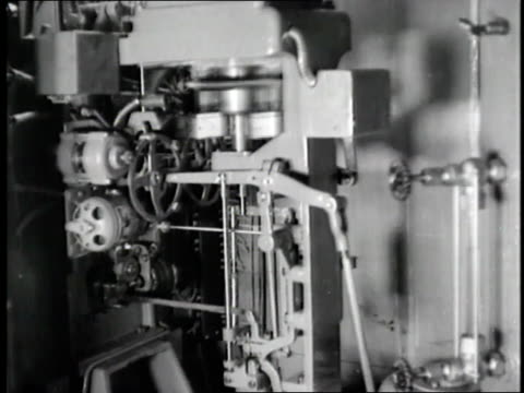 machinery and pumps operate inside the hoover dam - anno 1936 video stock e b–roll
