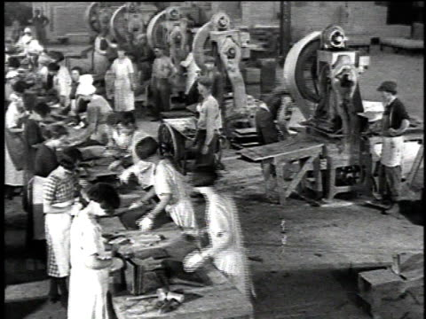 vídeos de stock, filmes e b-roll de 1921 montage machinery and workers in a shingle factory / united states - 1920