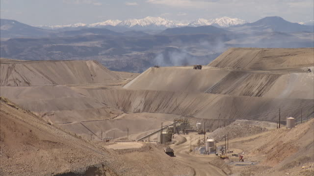 ws machinery at gold mine with mountains in background / victor, colorado, united states  - remote location stock videos & royalty-free footage
