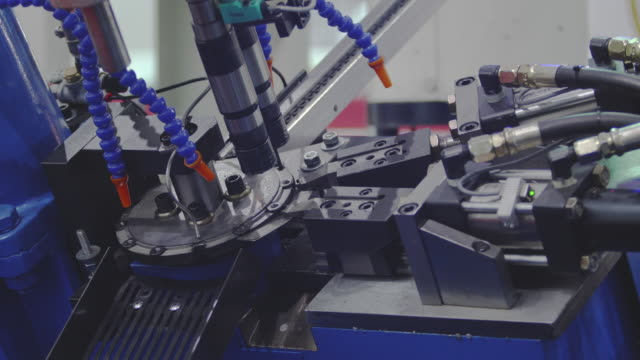 machinery; nut bolts screw making machine assembly-line produces small nut. - bolt stock videos & royalty-free footage