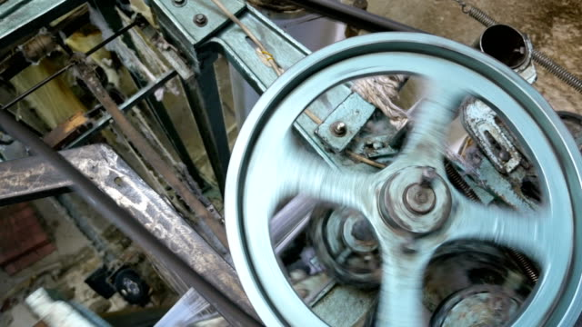 machinery part of a retro classical style weaving machine - needle plant part stock videos and b-roll footage